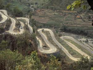 The Road to Kathmandu Winding up Through Foothills from the Gangetic Plain, Nepal by David Beatty