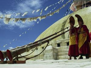 Two Monks Blowing Long Horns, Nepal by David Beatty