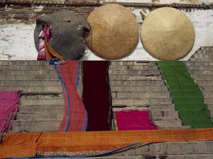 Woman Laying Saris Out to Dry, Varanasi, Uttar Pradesh, India by David Beatty