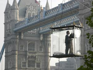 David Blaine, the American Illusionist and Street Magician in Front of Tower Bridge in London
