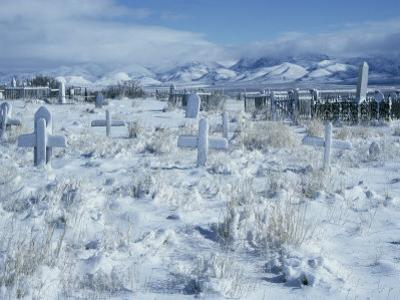 A Dramatic Winter Scene of a Snow-Covered Graveyard