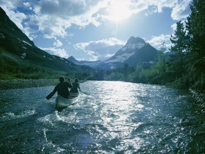 Canoeists on Swiftcurrent Creek by David Boyer