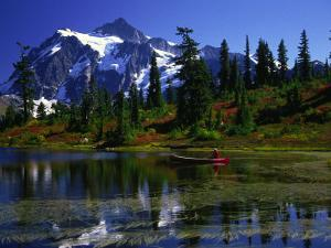 Man in Canoe, Picture Lake, WA by David Carriere