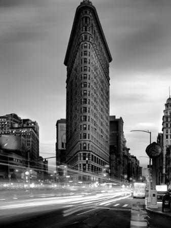 Black and white Flatiron Building in Manhattan New York and light trails at sunset purple clouds