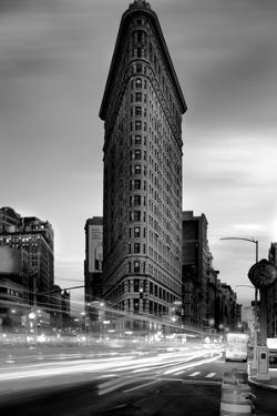 Black and white Flatiron Building in Manhattan New York and light trails at sunset purple clouds by David Chang