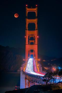 Full blood red moon rising over the Golden Gate Bridge in San Francisco, view from Battery Cranston by David Chang