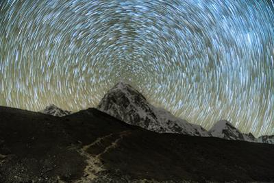 Star trails over Pumori Peak in the Himalayas, Nepal hiking to Everest Base Camp from Gorak Shep by David Chang