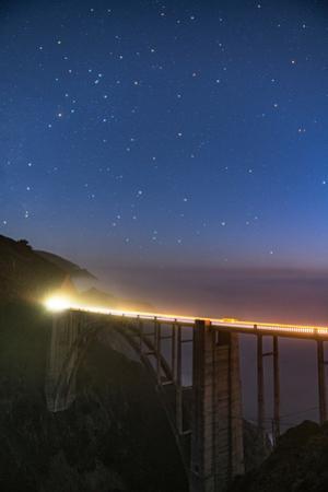 Stars over Big Sur's Bixby Creek Bridge near Monterey, California at night along the coast