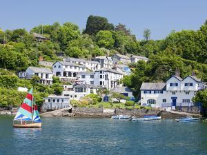 A Dinghy Sails Past the Village of Boddinick Near Fowey, Cornwall, England, United Kingdom, Europe by David Clapp