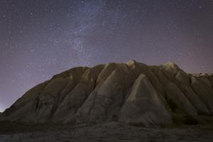 Night Time in the Rose Valley Showing the Rock Formations and Desert Landscape Light by David Clapp
