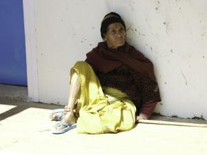 Old Woman Sitting Against a Wall, Nepal by David D'angelo