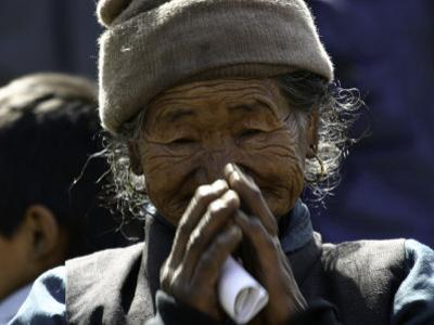Old Woman with Hands to Face, Nepal by David D'angelo