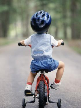 Little Boy Riding His Bicycle with Helmet by David Davis