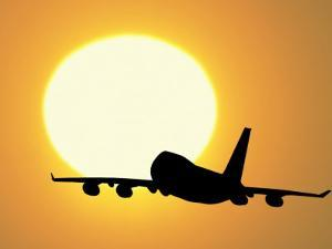 Silhouette of Airplane with Sun by David Davis