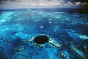 An Aerial View of the Blue Hole Off of the Coast of Belize by David Doubilet