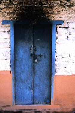 A Colorful Painted Doorway Is in Katmandu City by David Edwards