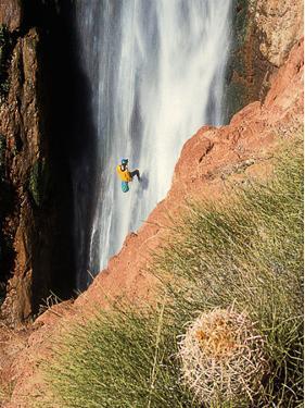 A Man Rappelling Down Deer Creek Falls by David Edwards