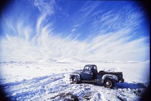 A Pickup Truck Sits in a Snowscape after a Desert Snowstorm by David Edwards