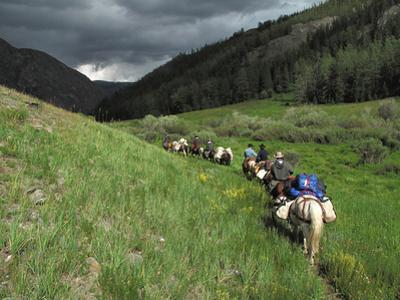 A Train of Horsemen Trek Along Western Mongolia Near Chinese Border