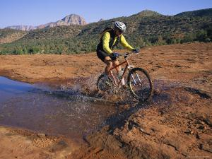 Cyclist Going Through Puddle, Arizona by David Edwards
