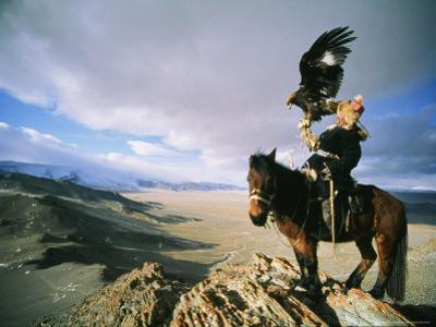 Hunter on Horseback Atop a Hill Holding a Golden Eagle in Mongolia