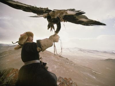 Kazakh Hunter Strains to Support a Golden Eagle