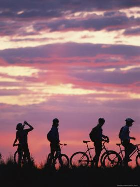 Silhouetted Cyclists Take a Water Break, Northern Arizona by David Edwards