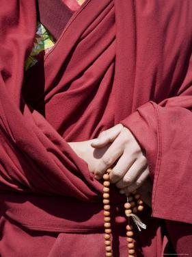 Close Up of a Buddhist Monk's Hands with Prayer Beads, Qinghai, China by David Evans