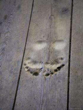 Footprints Carved in Wooden Floor of Buddhist Temple Entrance, China by David Evans