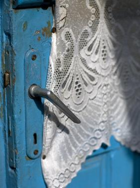 Lace Curtain and a Blue Door by David Evans