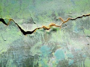 Rusty Crack in Layers of Paint on Old Truck by David Evans