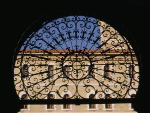 Wrought Iron and Stone Arch Entrance to the American University by David Evans