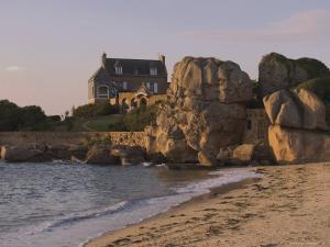 Beach House Built Behind Rocks, Tregastel, Cote De Granit Rose, Cotes d'Armor, Brittany, France by David Hughes