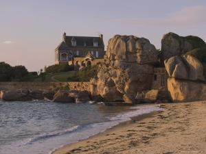 Beach House Built Behind Rocks, Tregastel, Cote De Granit Rose, Cotes d'Armor, Brittany, France by David Hughes