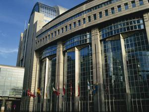 Flags Outside the European Commission and Parliament Buildings in Brussels, Belgium, Europe by David Hughes