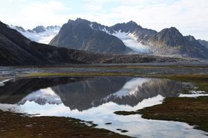 Mountains and Reflections at Magdelenefjord, Svalbard by David Lomax