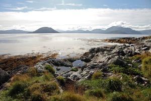 Sunlit Rocks and Foreshore, Helgoy, Kvalsund, Troms, North Norway, Norway, Scandinavia, Europe by David Lomax
