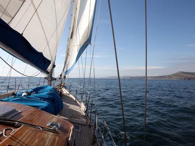 Yacht Sailing West Along the Coast, Dorset, England, United Kingdom, Europe