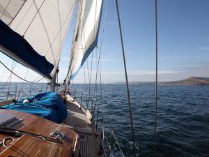 Yacht Sailing West Along the Coast, Dorset, England, United Kingdom, Europe by David Lomax