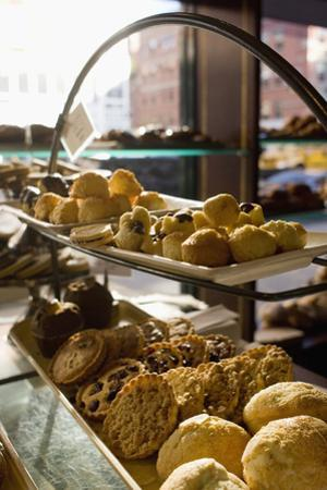 Assorted Pastries on Display in a Cafe by David McGlynn