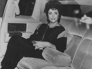 Actress Elizabeth Taylor Sitting in the Back of a Limo by David Mcgough