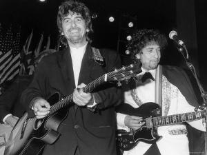 Musicians George Harrison and Bob Dylan Performing at Rock and Roll Hall of Fame by David Mcgough
