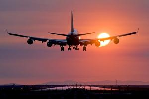 Aeroplane Landing At Sunset, Canada by David Nunuk