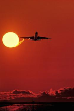 Boeing 747 Taking Off At Sunset by David Nunuk