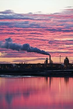 Oil Refinery At Sunset by David Nunuk
