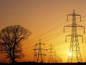 Pylons And Power Lines At Sunset by David Parker