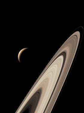 Titan's Lakes And Saturn's Rings by David Parker