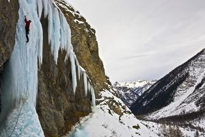 An Ice Climber Ascending a Frozen Cascade in the Fournel Valley, Ecrins Massif, France, Europe by David Pickford