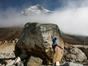 Climber Tackles a Difficult Boulder Problem on the Glacial Moraine at Tangnag by David Pickford