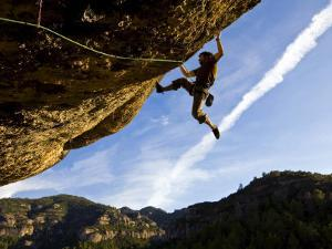Climber Tackles Difficult Route on Overhang at the Cliffs of Margalef, Catalunya by David Pickford